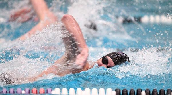 Max Phillips finished first in the 200-yard freestyle helping the Violets Defeat Cortland in their season opener.