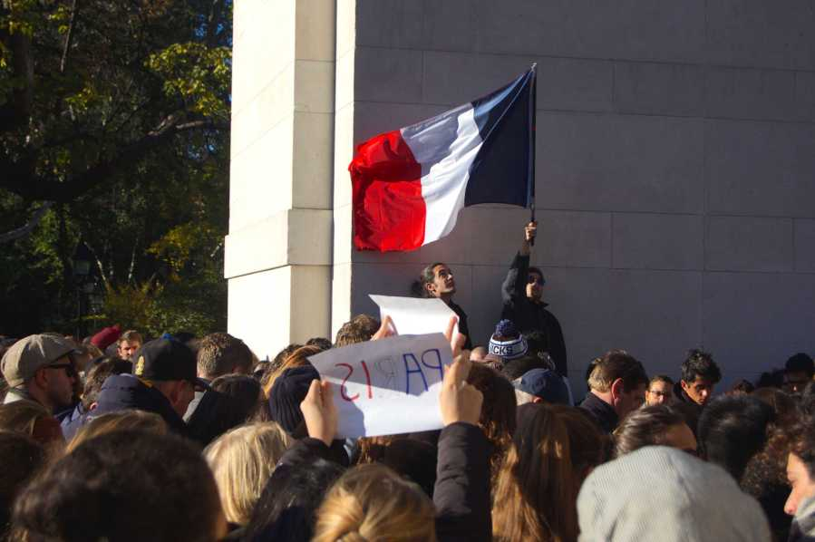 Hundreds gathered in Washington Square Park on Saturday, waving French flags and signs of solidarity with Paris.