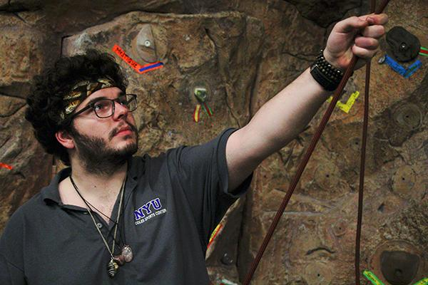 Jeremy Eckl at work by the Rock Wall in Palladium Athletic Facility.