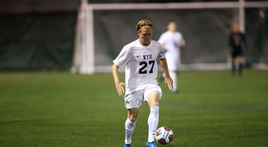 Stern freshman, Owen Smith, scores the last goal in the Violets' game against Maritime.