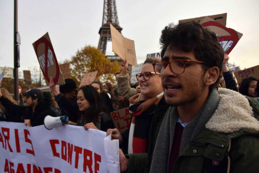 Americans and French nationals rallied together against U.S. President-elect Donald Trump in Paris on Saturday afternoon.