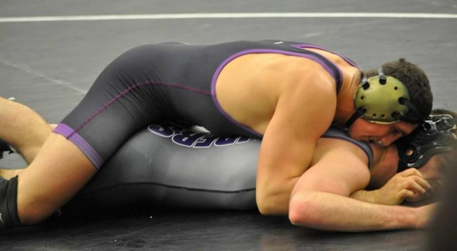 Junior captain of NYU's wrestling team, Raymond Jazikoff, won all four of his bouts in the first dual matches of 2016-2017.