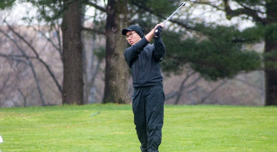 """Qizhi Wong, sophomore golfer, mutters """"come on Cheech"""" as part of his pre-shot routine."""