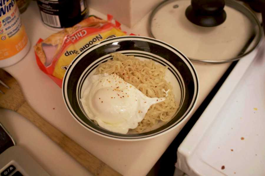 Eating instant ramen everyday can become a bore.  Spice up your life by panfrying it and adding a poached egg.