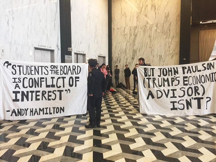 Protesters gathered at Schwartz Plaza today to demonstrate in favor of the recent SSC vote and an NYU Board of Trustees member's connection to President Donald Trump. At one point, protesters were positioned in front of the elevator that goes  to President Andrew Hamilton's office.