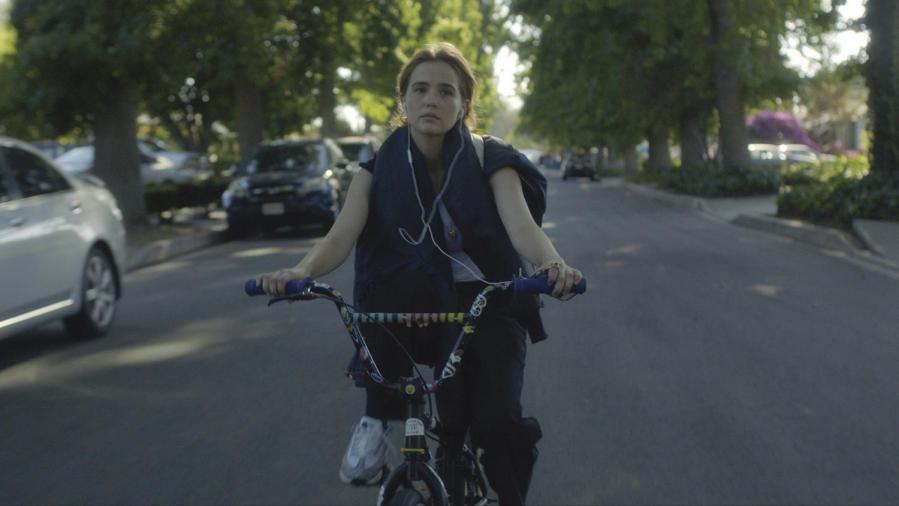 Zoey Deutch plays Erica Vandross in