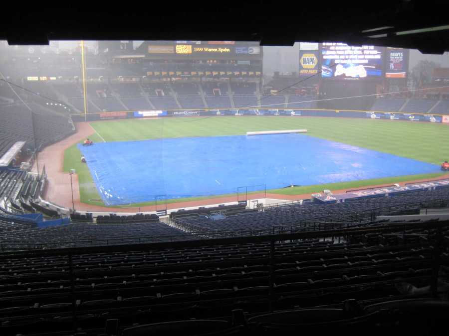 The Turner Field in Atlanta faces a rain delay. Weather can deter a game from effectively playing out; in addition, it can affect how players play the game.