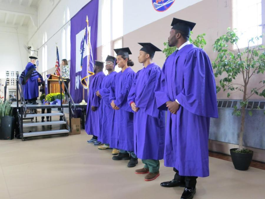 President Hamilton and Gallatin Dean Susanne Wofford attended the first graduation of NYUs Prison Education Program where five students received associates degrees in Liberal Studies.