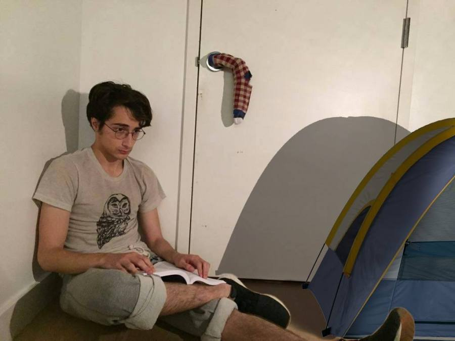 Hopeful senior Chris Stert camps out by door hoping to be first inside his own bedroom.