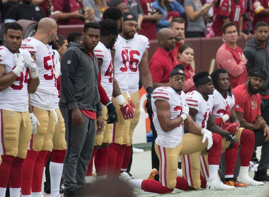 Various NFL players have knelt during the playing of the playing of the national anthem to protest police brutality and racial violence. Critics have labelled these players as anti-militaristic, so many players chose to stand on veterans day out of respect to the military.