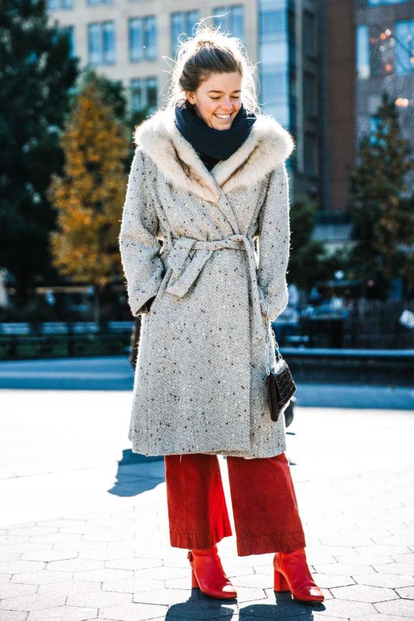 Scarves and coats both are fashionable items to keep warm in winter, of course, a pair of eye-catching boots is a plus.