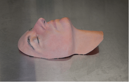 A sample mask, featuring Leslie Bernstein, administrator for the Hansjӧrg Wyss Department of Plastic Surgery and Face Transplant Program at NYU Langone Health.