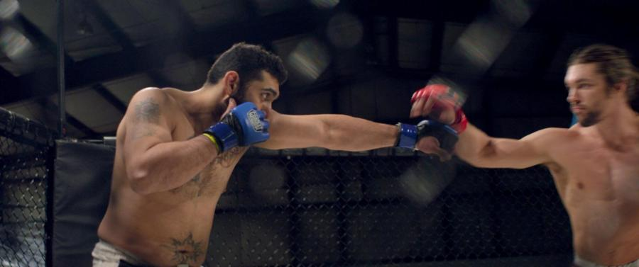 """Joe Carman throws a punch in Jeff Unay's new documentary, """"The Cage Fighter,"""" now showing at the IFC Center on Sixth Avenue."""