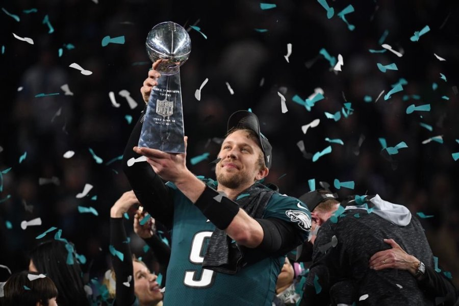 Philadelphia Eagles quarterback Nick Foles holds up the Superbowl trophy after their victory over the New England Patriots on Feb. 4.