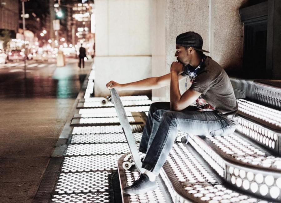An NYU skateboarder takes a break from skating around Lower Manhattan.