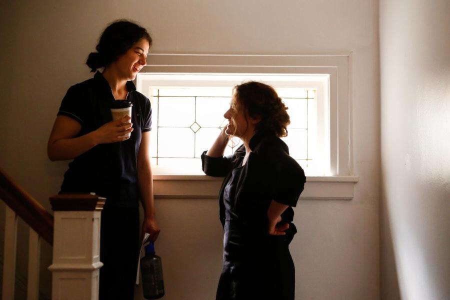 Emma Seligman and Rachel Sennott talking on the set of Shiva Baby.