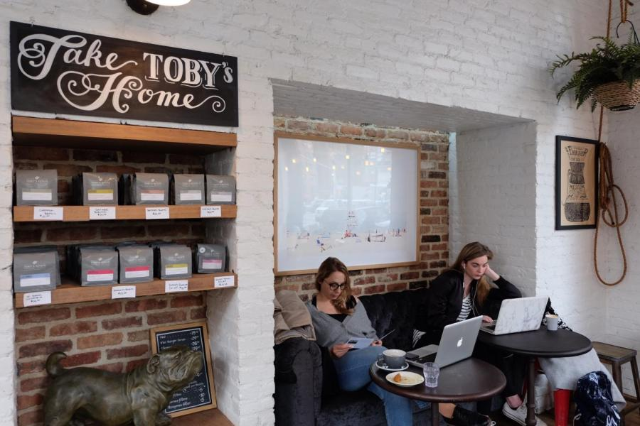 Customers with laptops at Toby's Estate Coffee in the West Village.