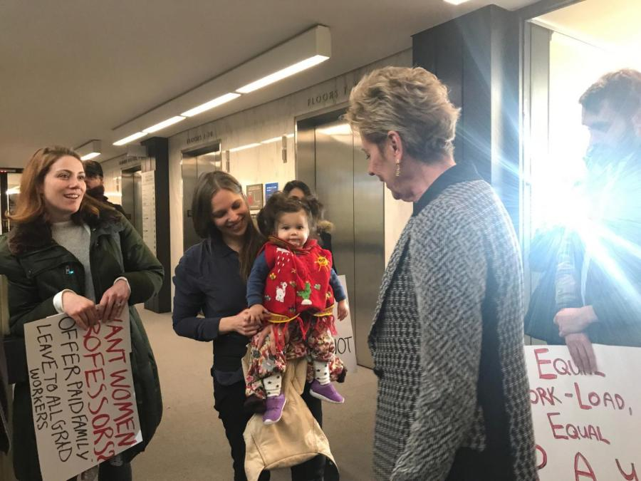 On Mar. 8, the Graduate Student Organization Committee held a rally at NYU Bobst Library. Lynne P. Brown, Senior Vice President for University Relations and Public Affairs talks to protesters on the 10th floor.