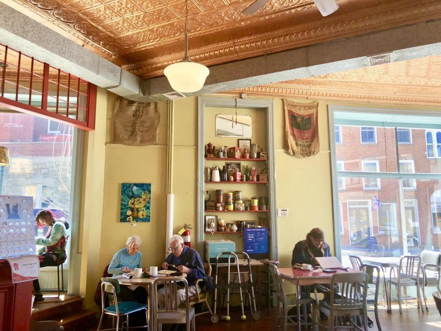 In and out of the Bean Runner Cafe; the light atmosphere and soft jazz welcomes visitors and residents to relax.