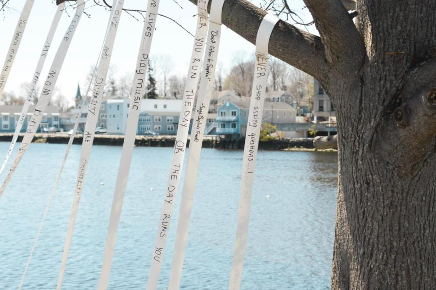 Quotes tied to a tree by the community in Westport, Connecticut.