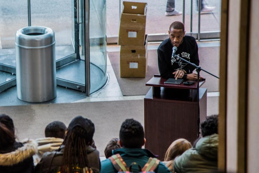 Akeem Muhammad, Tisch 18, speaks at a vigil for Stephon Clark. In his speech, he discussed the importance in faith and used throwing hands as an analogy for action: Throw hands in the classroom; throw hands in the voting booth; throw hands in the cities and in the suburbs; throw hands in the streets and in the subways.