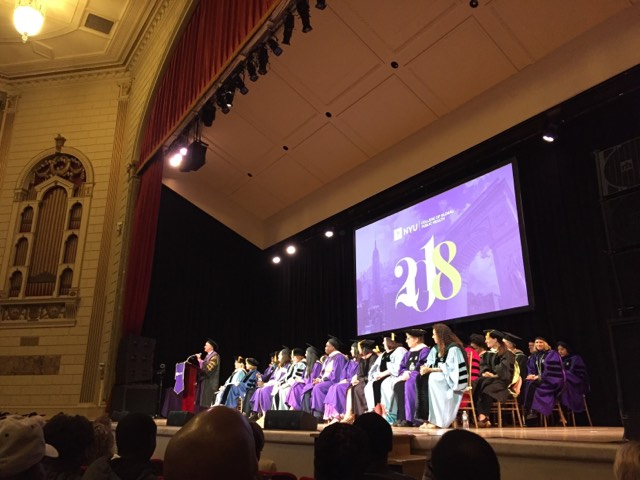 President Andrew Hamilton addresses graduates and their families at the College of Global Public Health commencement ceremony held in The Town Hall in midtown.