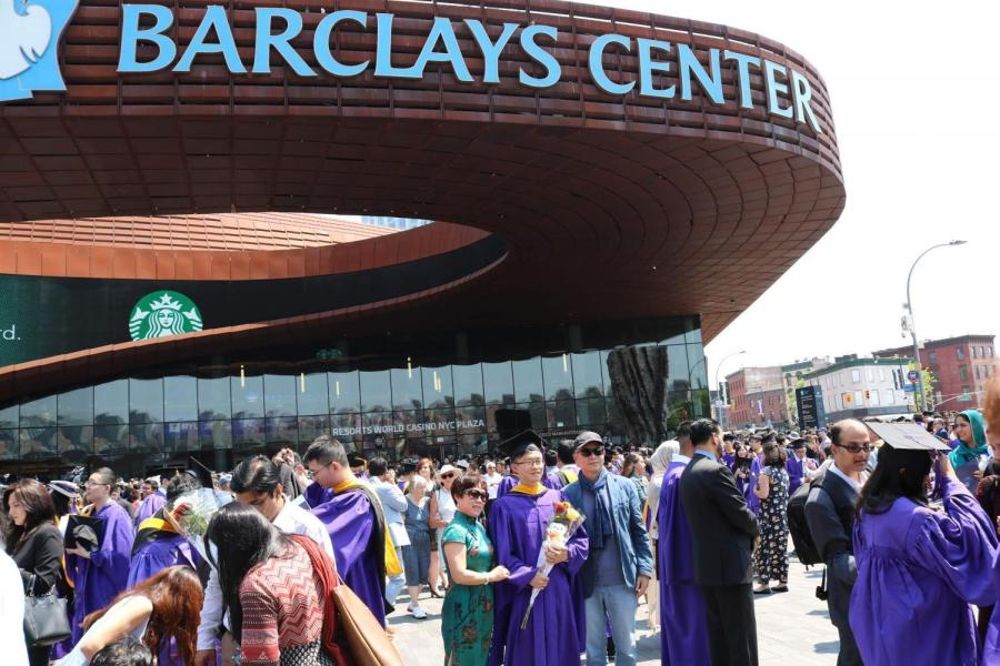 Graduates pose for photos with friends and family outside the Barclays Center where Tandon's graduation ceremony just took place.