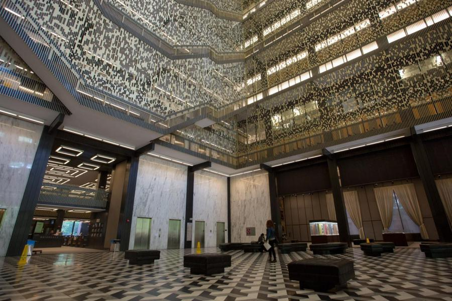 Interior+of+Elmer+Holmes+Bobst+Library+lined+with+aluminum+panels.++