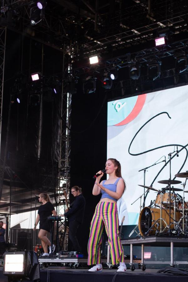 Norwegian artist Sigrid bopped around the Pavilion Stage in her colorfully striped pants and flouncing pony tail.