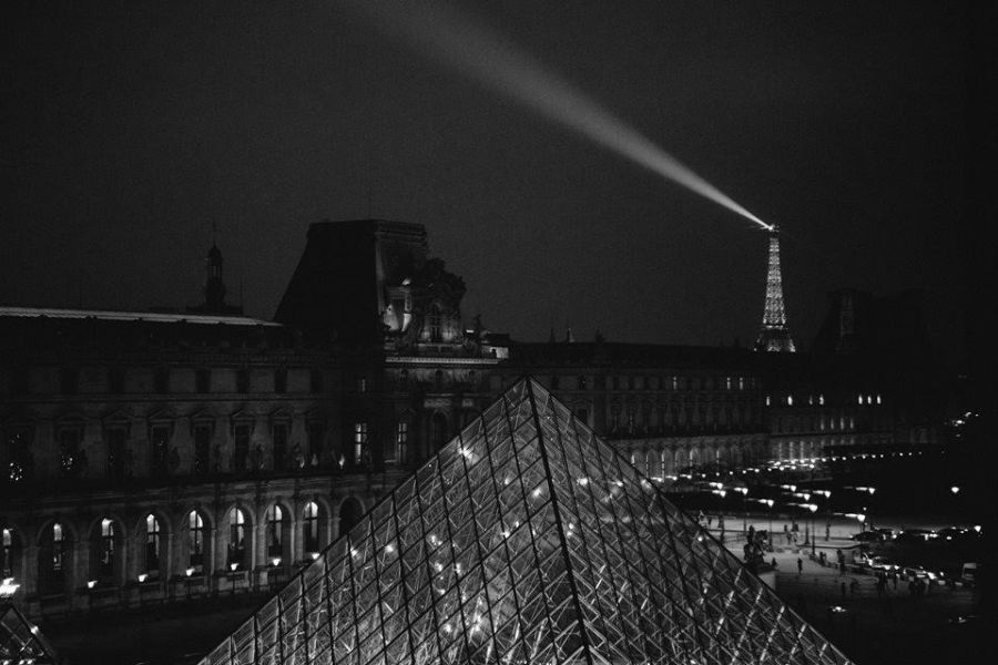 The Louvre and the Eiffel Tower at night.