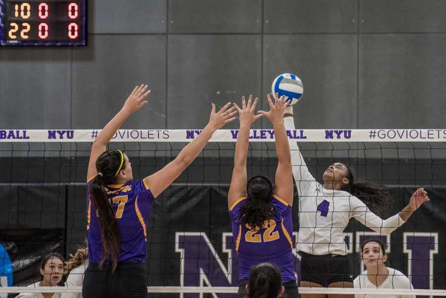 Nazzarine Waldon spikes the ball in a home win over Hunter College on the team's Senior Day. (Photo by Sam Klein)