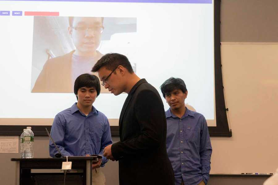 A team presentation at the Super Hacks competition. Teams worked to create start up ideas involving AI. (Photo by Alana Beyer)