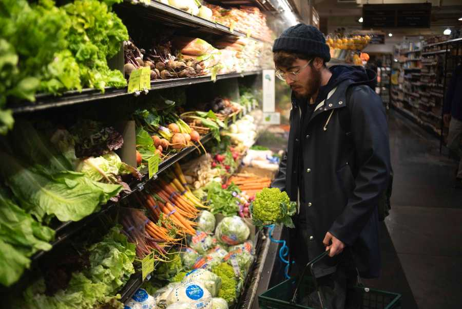 Student chef Nino Asaro aims to purchase the freshest vegetables. (Photo by Justin Park)