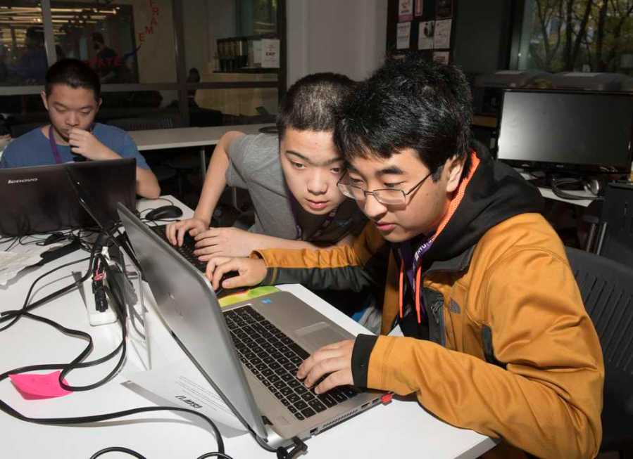 Two+participants+of+the+2017+Cyber+Security+Awareness+Week+hackathon.+%28via+csaw.engineering.nyu.edu%29