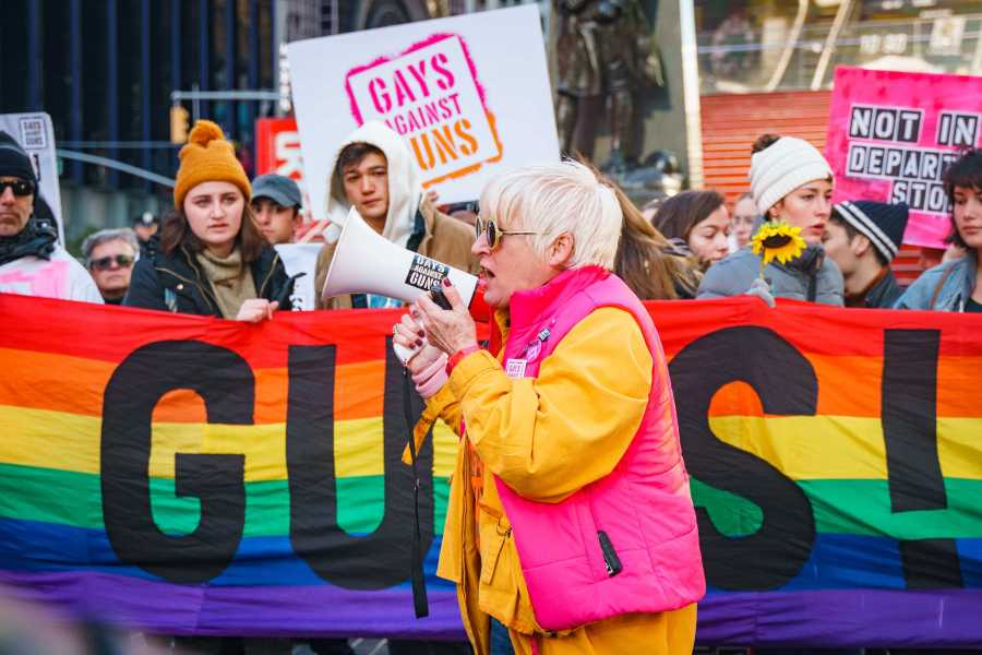 Brigid McGinn speaking during the protest. McGinn is a member of Gays Against Guns, the organizer of the rally. (Photo by Tony Wu)