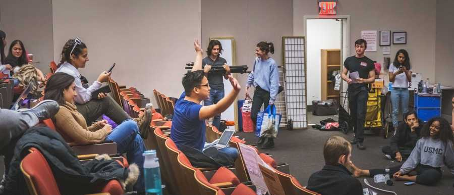 """Eric Gelb reviews the cast' performance after the rehearsal. """"I've dedicated my life to it, and I'd be off without it,"""" says Gelb as he was asked his relationship with the theatre. (Photo by Tony Wu)"""
