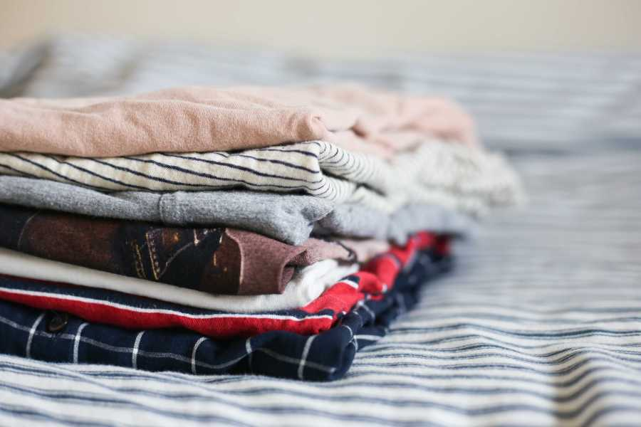 A pile of folded clothing, ready to be donated. (Staff Photo by Julia McNeill)