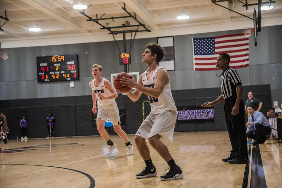 CAS first-year Alex Casieri sets up for a 3-pointer during a game in December. (Photo by Sam Klein)
