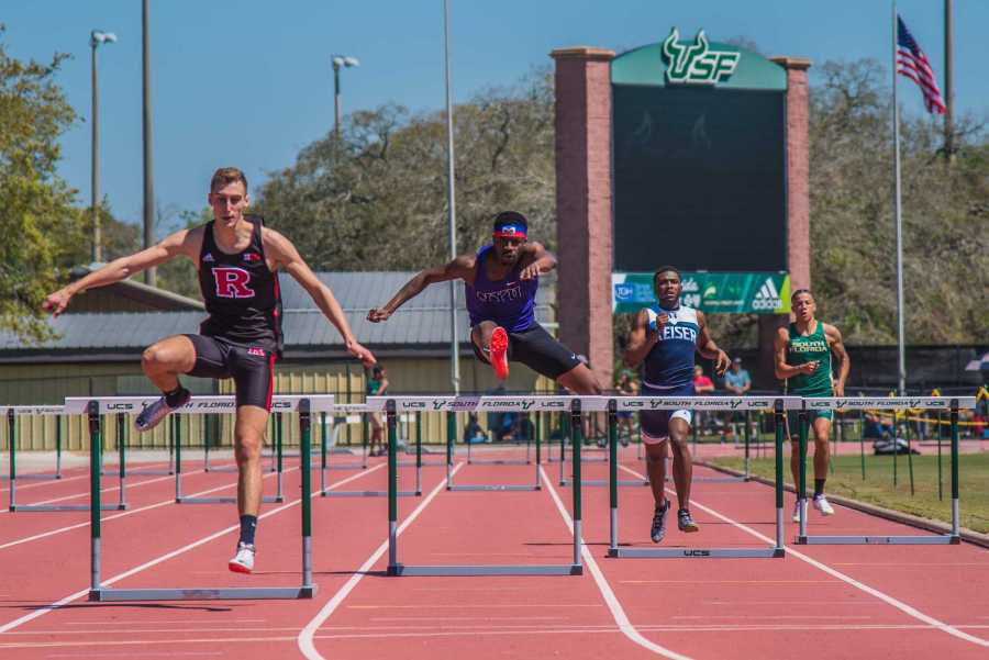 SPS junior Julian Montilus runs the 400m hurdles at the USF Bulls Invitational on Saturday. He placed sixth overall in the event. (Photo by Sam Klein)