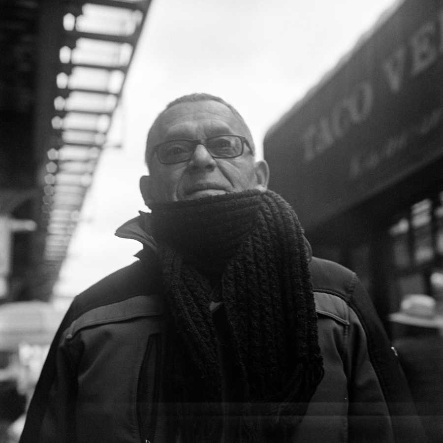 I stopped him while he was walking down the street and asked for a portrait. He looked above the camera, never directly at me.