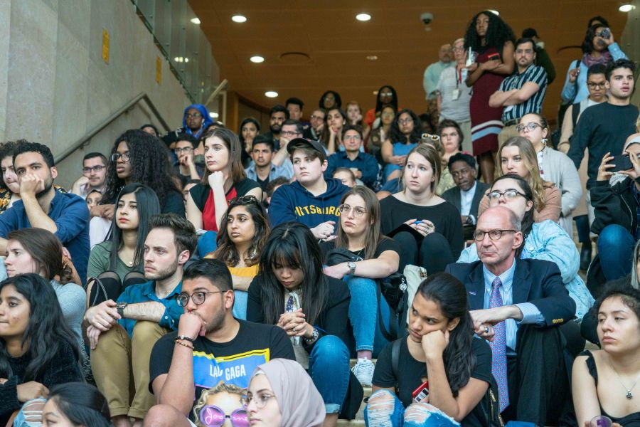 Students observe a moment of silence in honor of the victims of Sri Lankan bombings. (Alana Beyer)