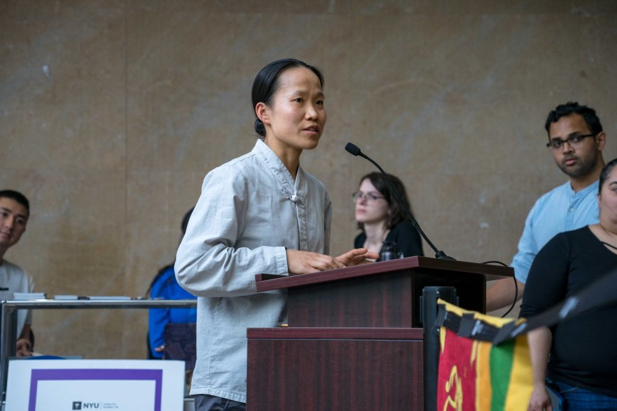 Rev. Doyeon Park, Buddhist chaplain for NYU's Center for Global Spiritual Life, leads vigil attendants in a prayer honoring victims, and promoting healing. (Alana Beyer)