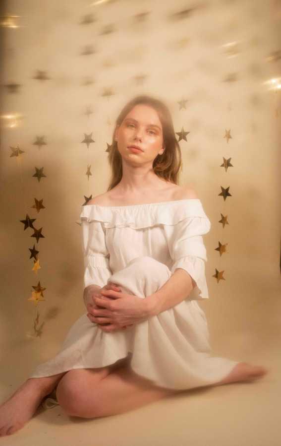 FALLEN STARS | Caroline wearing Vestire white off-the-shoulder prairie dress. (Photo by Katie Peurrung)
