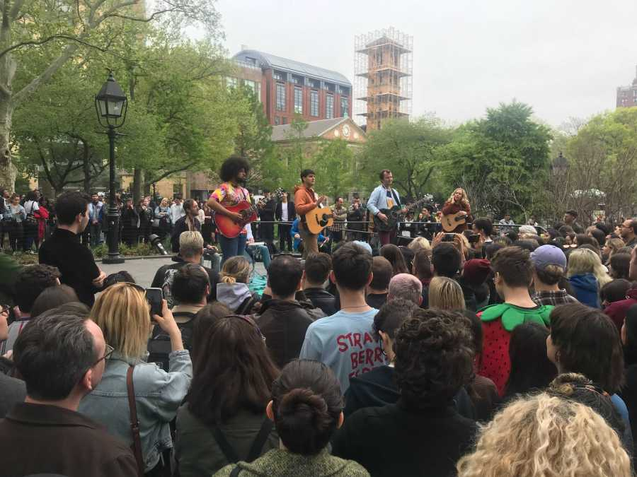 Left to right: guitarist Brian Robert Jones, Ezra Koenig, Chris Baio and touring guitarist Greta Morgan, of Vampire Weekend. The band played an impromptu acoustic show in Washington Square Park on the release day of their new album