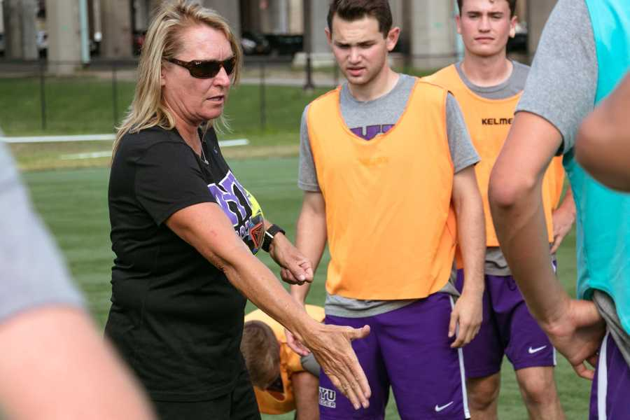 NYU+men%E2%80%99s+soccer+coach+Kim+Wyant+directs+players+on+the+field.+%28Staff+Photo+by+Marva+Shi%29