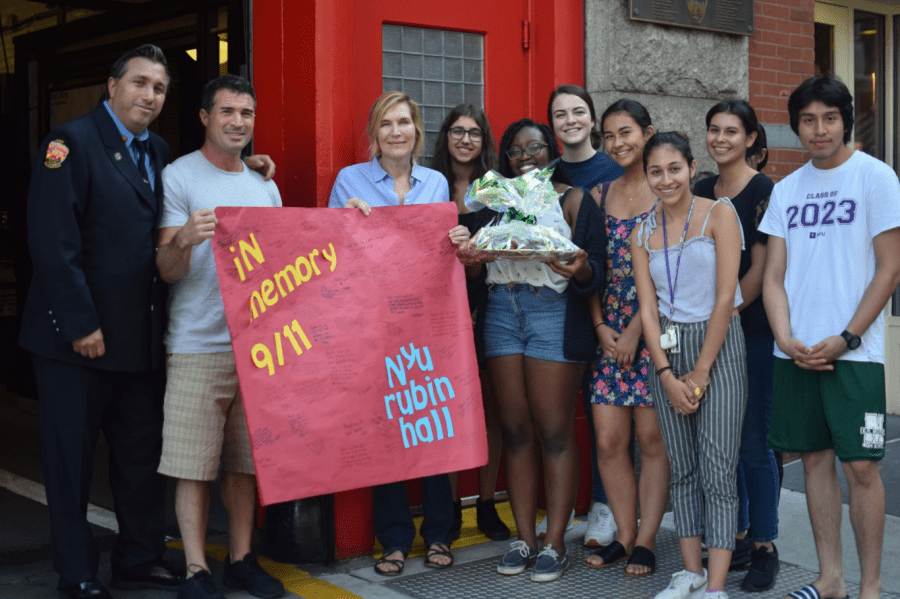Heidi and students wait outside FDNY Squad 18s fire station. (Photo by Ronni Husmann)