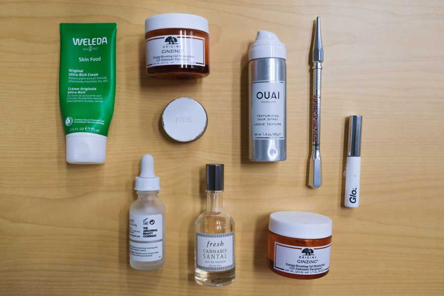 From Origins to Glossier, a myriad of used-up skincare and makeup items are scattered across a table. Our staff delves into which empties they loved, and others they wouldn't use again. (Staff Photo by Elaine Chen)