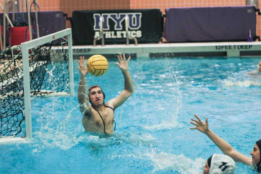 NYU's water polo team practices. Both the coach and athletes emphasized the sense of community they have found on the team. (Photo by Alex Tran)