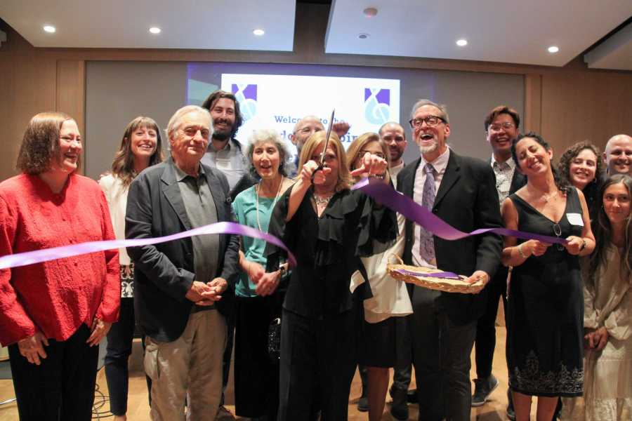 Dean Morris cuts the ribbon, officially opening the Nordoff-Robbins Center with Robert De Niro (left). (Photo by Alexandra Chan)