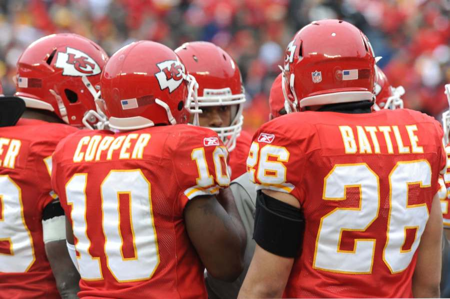 Members of the Kansas City Chiefs huddle with special team's coordinator during the Kansas City Chiefs wild card game play-off. (via AFGSC)
